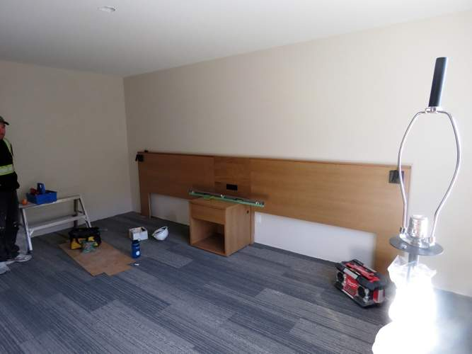 Carpet is installed and furniture is moved into the rooms on the 3rd floor of Kwa'lilas Hotel.
