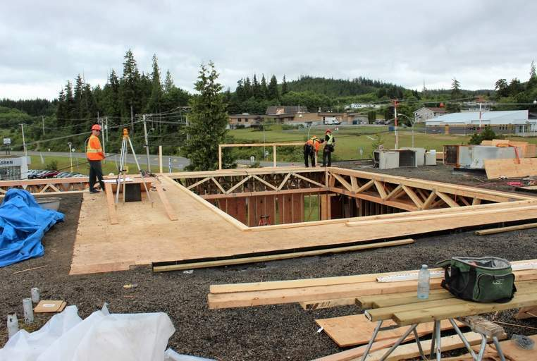 The south building's roof was opened up last week so that roof trusses could be lifted on.