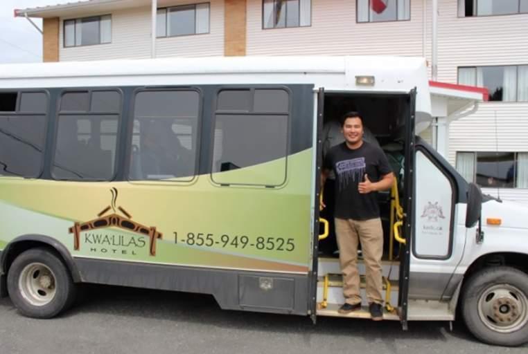 Eddie Walkus takes guests to their tours on the k'awat'si Tours mini coach.